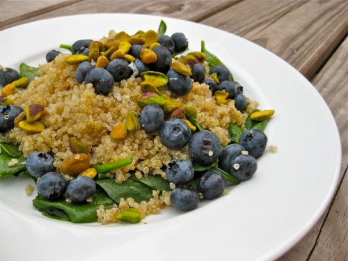 quinoa blueberry pistachio salad over greens